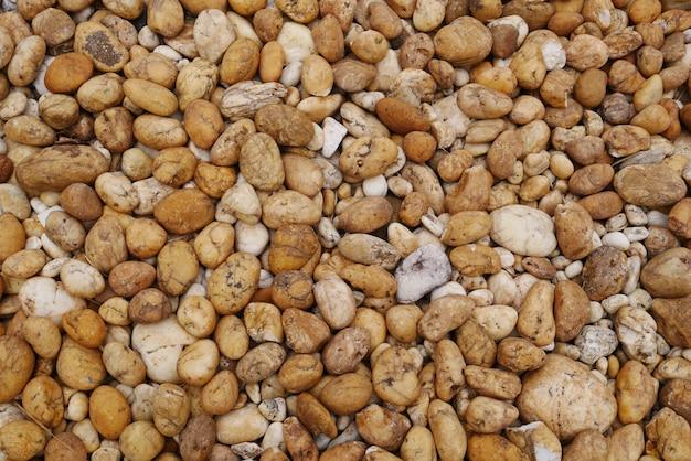 Brown pebble beach stone background Premium Photo