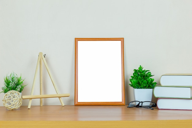 Brown picture frame on wood table. Premium Photo