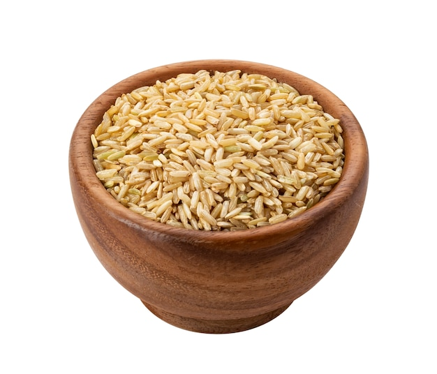 Brown rice groats in wooden bowl isolated Premium Photo