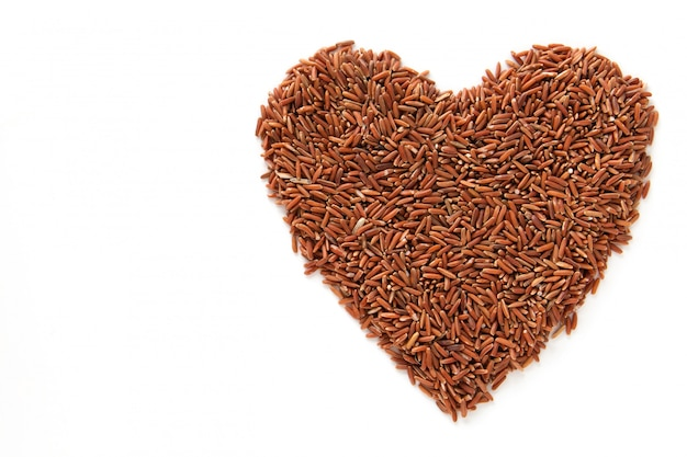 A brown rice is heart shape texture. Premium Photo