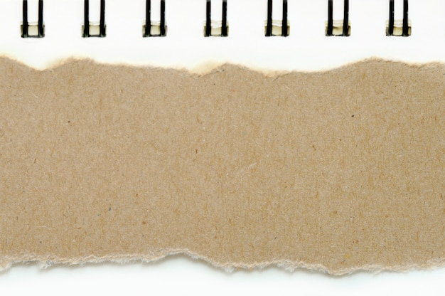 Brown ripped paper on book white paper color background Premium Photo