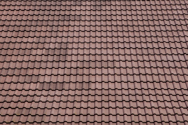 Brown roof with metal tile on blue sky Premium Photo