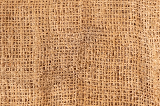 Brown sackcloth texture as a background, close up. Free Photo