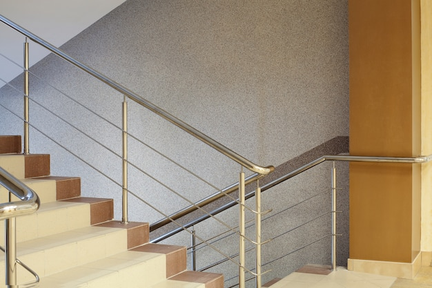 wrought iron handrails for stairs modern style home.htm brown staircase with metal railing  gray wall premium photo  staircase with metal railing  gray wall