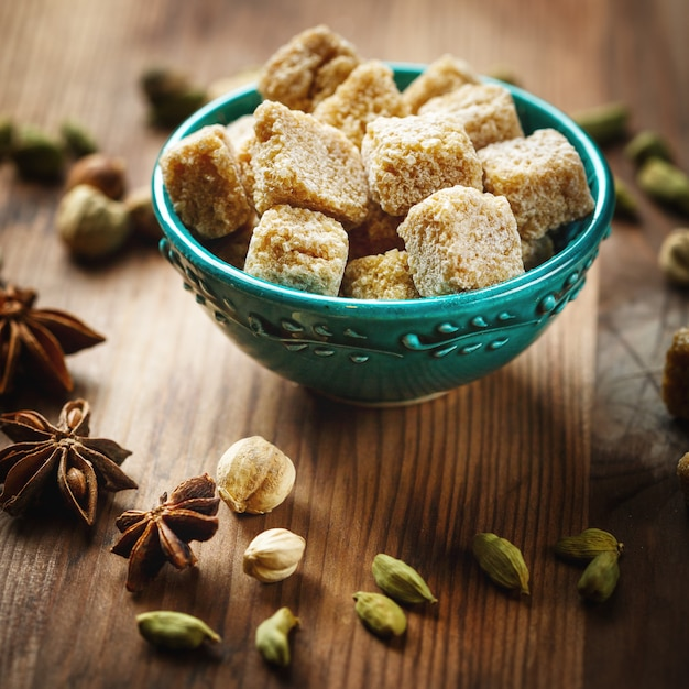 Brown sugar and spices cardamom and anise Premium Photo