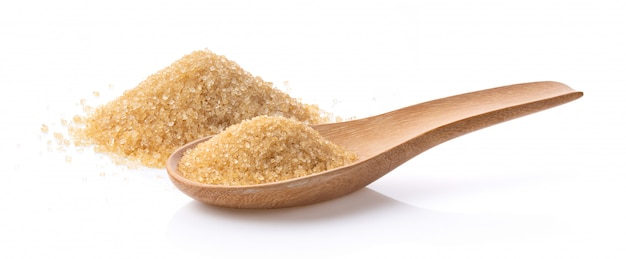 Brown sugar in wood spoon on white Premium Photo