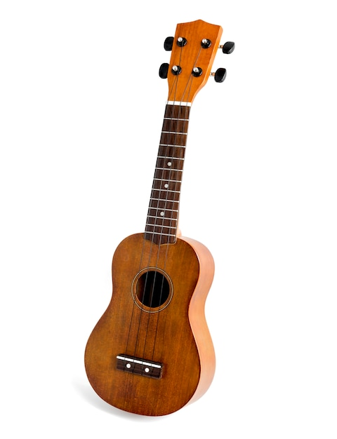 The brown ukulele on the white background, with clipping path Premium Photo
