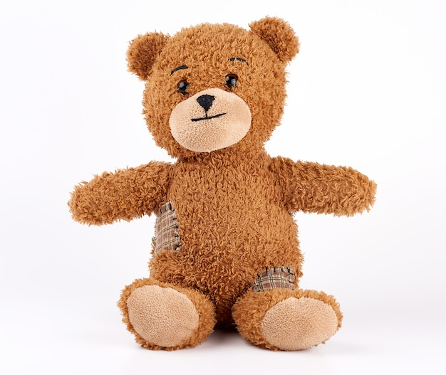 Brown vintage teddy bear with patches Premium Photo