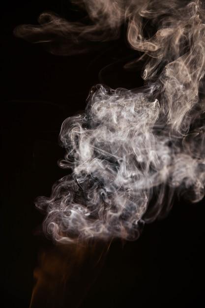 Brown wavy smoke on black background Free Photo