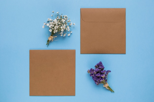 Brown wedding invitations with blue background Free Photo
