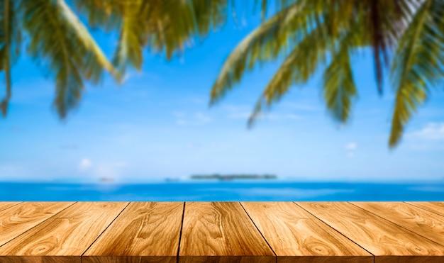 Brown wood table on summer tropical beach. Premium Photo