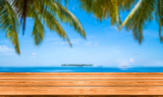 Brown wood table on summer tropical beach. Premium Photo