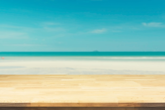 Brown Wood Table Top On Blurred Blue Sea And White Sand Beach Background.  Premium Photo