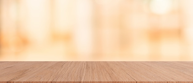 Brown wood tabletop with blurred restaurant bar cafe light color background f Premium Photo