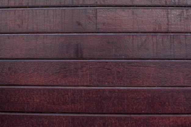 Fondo di legno marrone con laquer su di esso Foto Gratuite