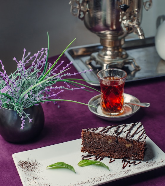 Brownie with black tea on the table Free Photo