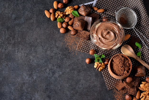 Brownies with nuts and chocolate on a black background Premium Photo