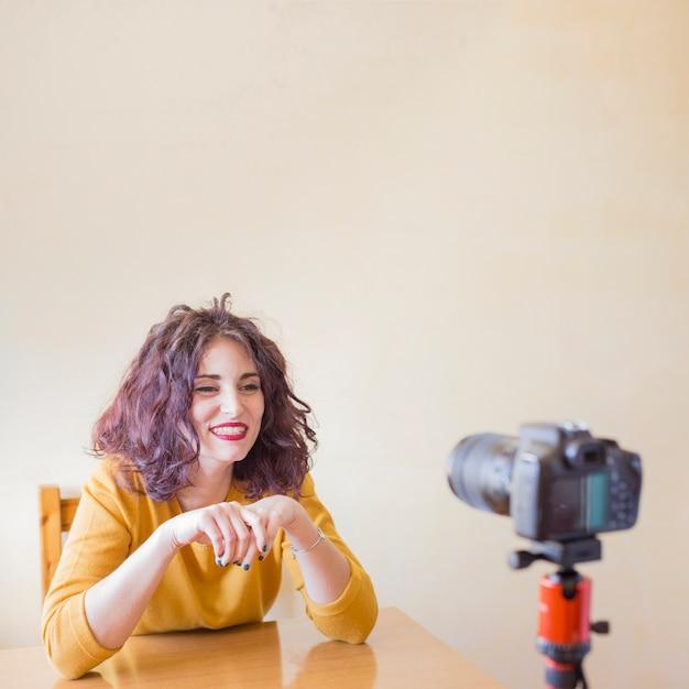 Brunette blogger recording a video Free Photo