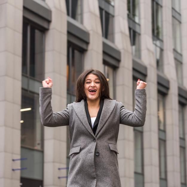 Brunette businesswoman celebrating Free Photo