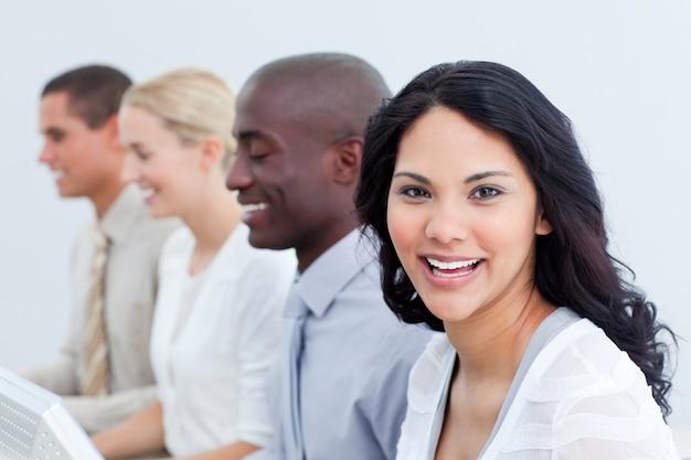 Brunette businesswoman and her team at work Premium Photo
