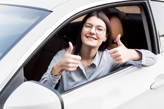 Brunette businesswoman inside a car Free Photo