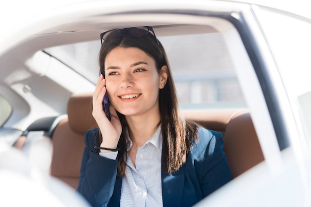 Brunette businesswoman inside a car Free Photo
