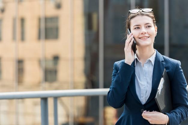 Brunette businesswoman outdoors Free Photo