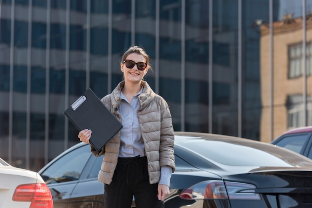Brunette businesswoman posing with sunglasses Free Photo