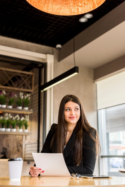 Brunette businesswoman with document Free Photo