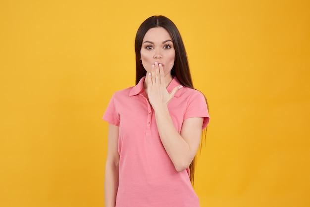 Brunette girl poses playfully shushing isolated. Premium Photo