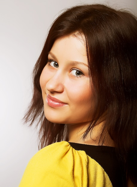 Brunette girl in yellow t-shirt Premium Photo