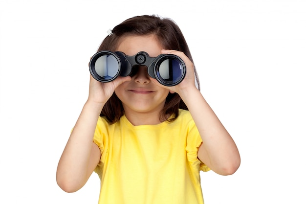 Brunette little girl looking through binoculars isolated on a over white background Premium Photo