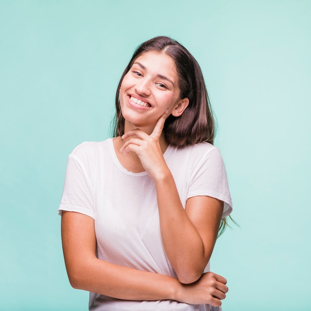 Brunette model posing with white t-shirt Free Photo