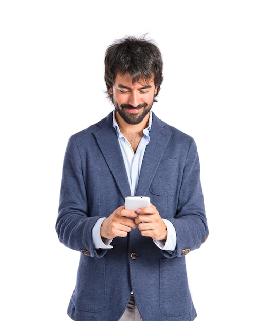 Brunetteman talking to mobile over white background Free Photo