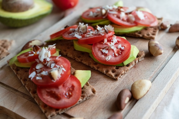 Bruschetta with avocado and tomatoes. Premium Photo