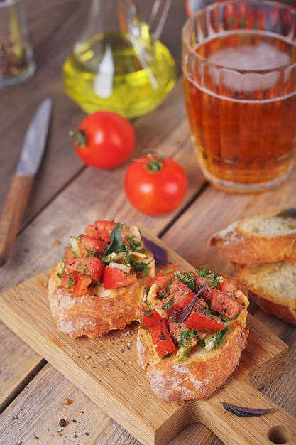 Bruschetta with chopped tomatoes, basil and herbs on grilled crusty bread. Premium Photo