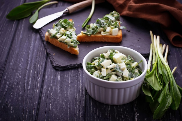 Bruschetta with ramson salad on slate background Premium Photo