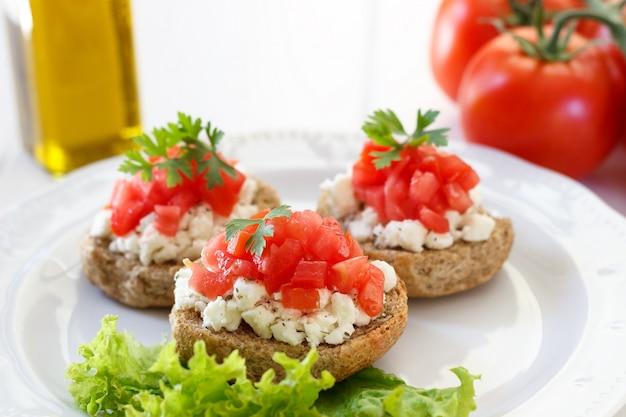 Bruschetta with tomato and feta cheese Premium Photo