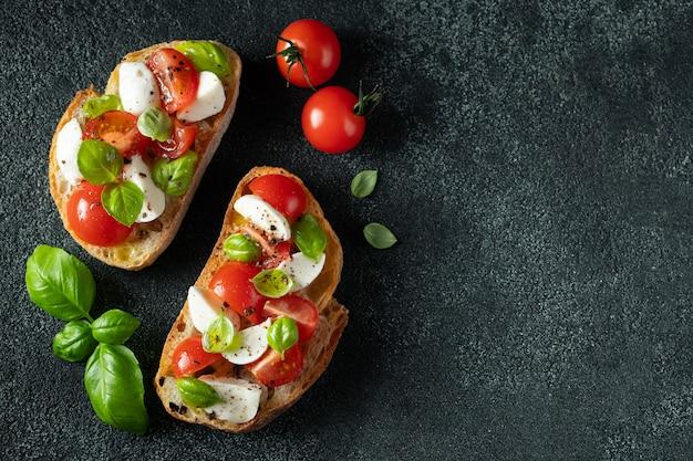 Bruschetta with tomatoes, mozzarella and basil. Premium Photo