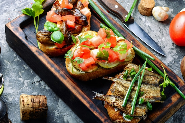 Bruschetta with various toppings Premium Photo