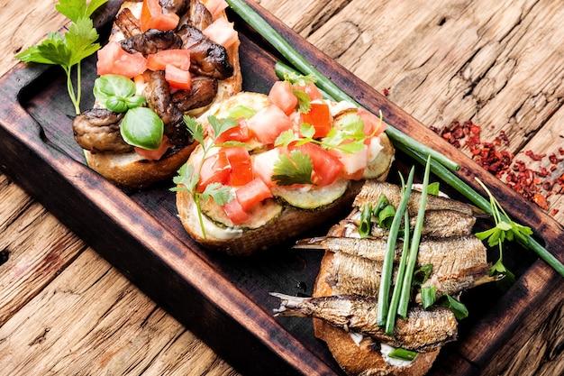 Bruschetta with various toppings. Premium Photo