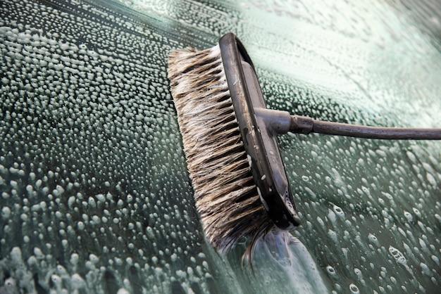 Brush for cleaning glass. Premium Photo