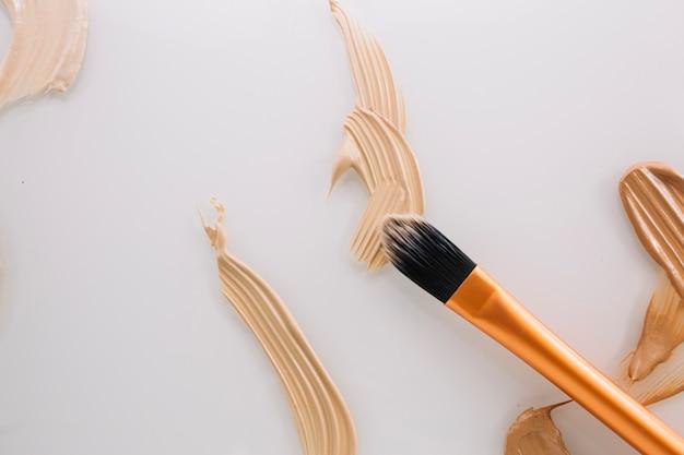 Brush on concealer stroke Free Photo