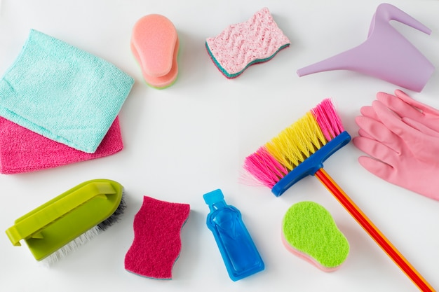 Brushes, rags, watering can, sponges, disposable gloves and cleaning products Premium Photo