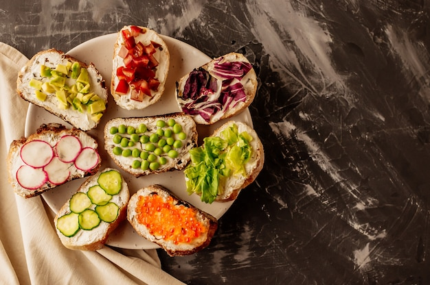 Brushetta or traditional spanish tapas. appetizers italian antipasti snacks set on wooden board. Premium Photo