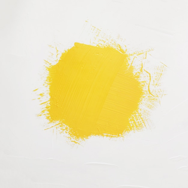 Brushstrokes of yellow paint with space for your own text Free Photo