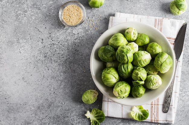 Brussels sprouts cabbage fresh organic in jar on table in kitchen Free Photo