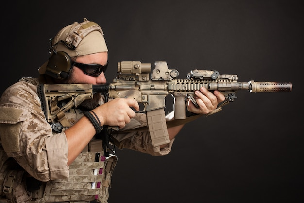 Brutal man aiming from his rifle. Premium Photo