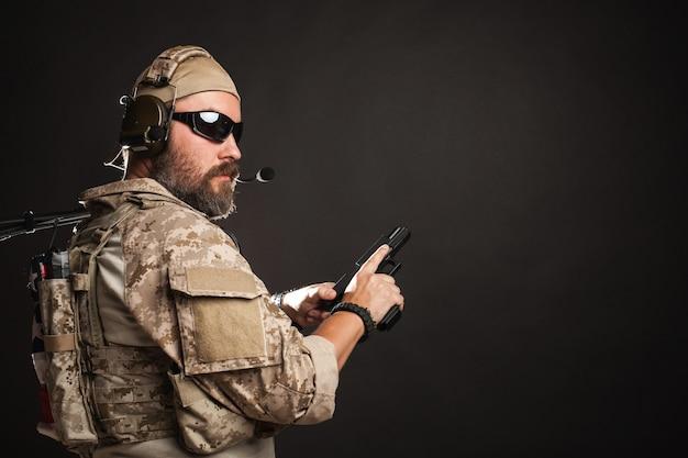 Brutal man in the military desert uniform. Premium Photo