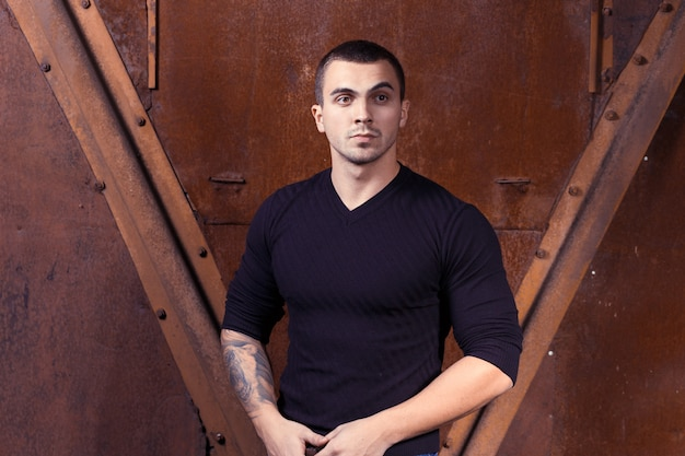 Brutal young sexual man in black sweater Premium Photo
